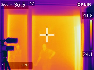 Thermal imaging camera showing temperature transfer outside to inside through energy efficient glass.