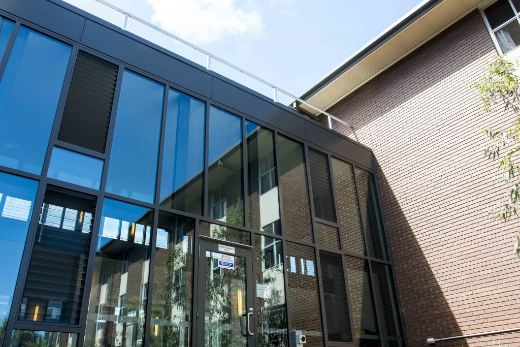 Architectural Glazing Systems : Mannix college a home away from edge architectural