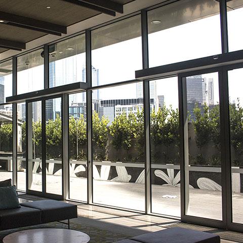 podium level architectural glazing system